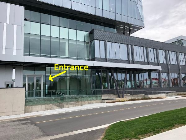 Glassy Google building, with front entrance indicated.
